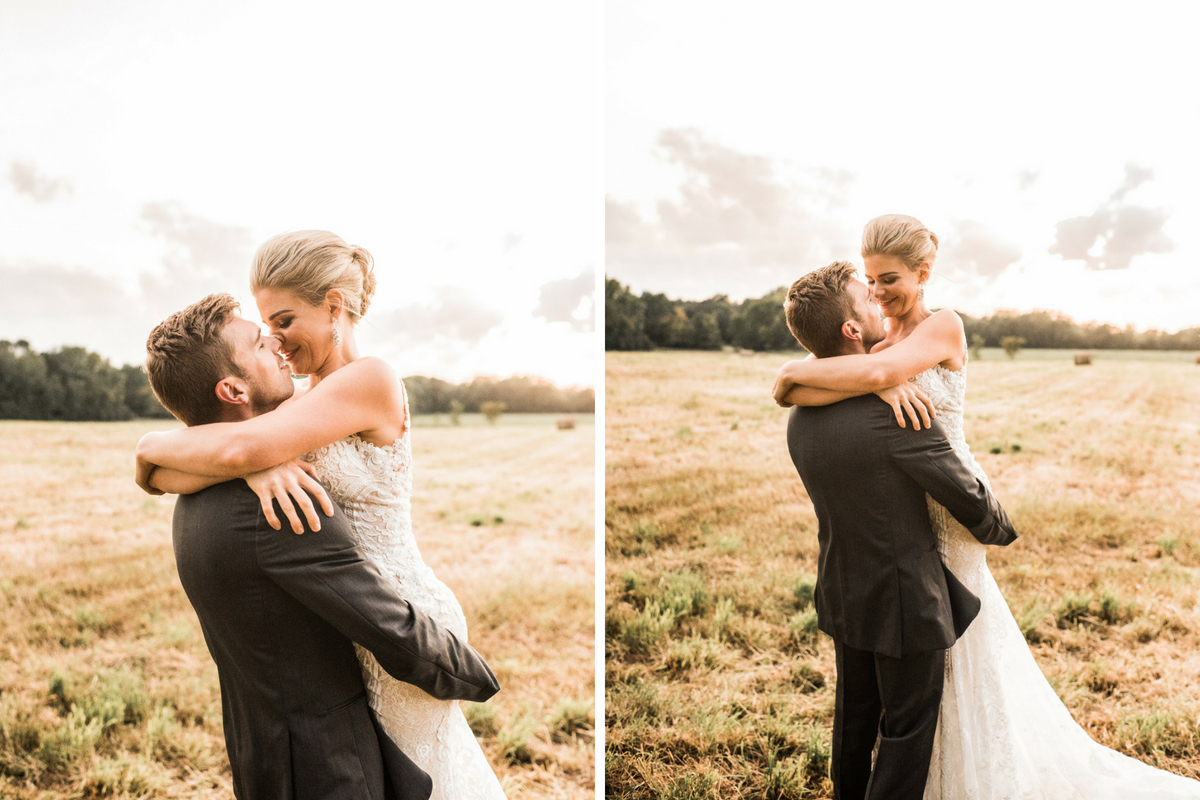 groom_holding_bride_smiling_in_bright_sunny_farm_field.jpg