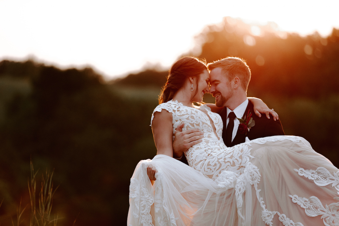 groom_holding_bride_sunset.jpg