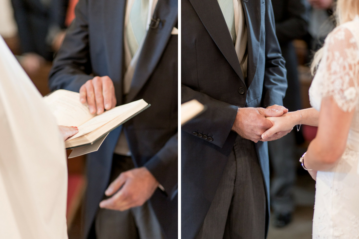 groom_holding_brides_hand_placing_hand_on_bible_during_wedding_ceremony.jpg