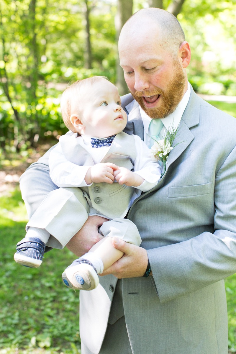groom_holding_little_boy_looking_at_each_other.jpg