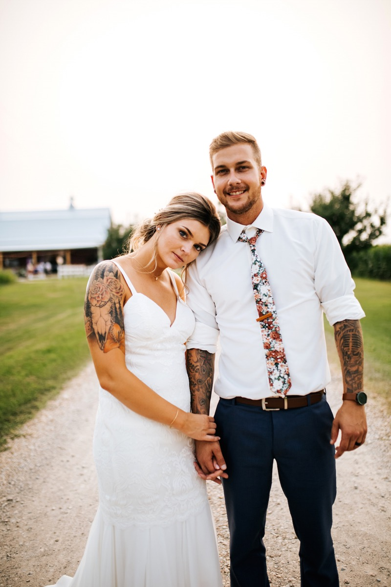 groom_in_floral_tie_blue_pants_rolled_up_white_shirt.jpg