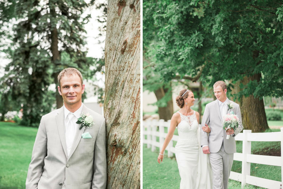groom_in_grey_suit_posing_by_tree_and_with_bride_walking_together_on_farm.jpg