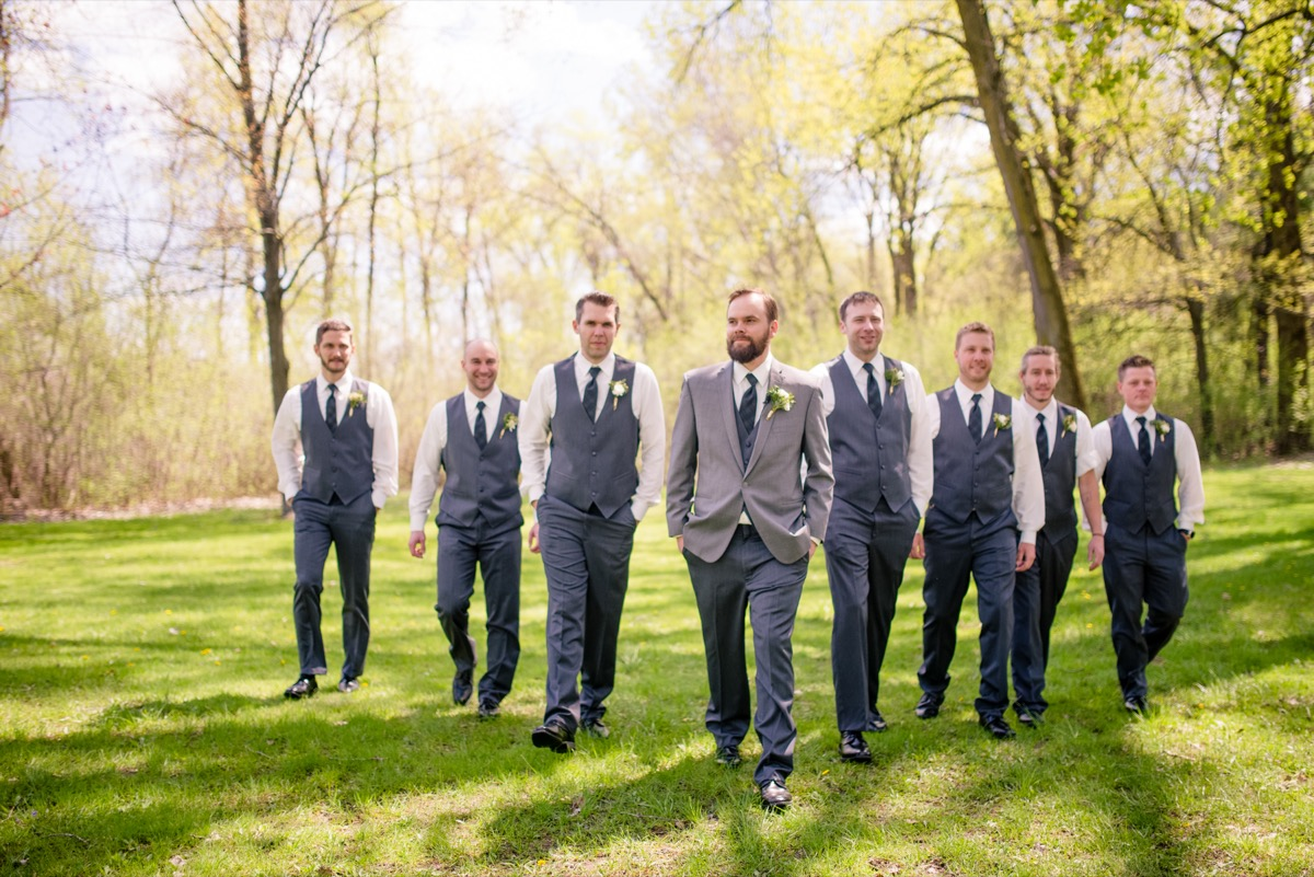 groom_leading_way_of_groomsmen_yellow_leaves_park.jpg