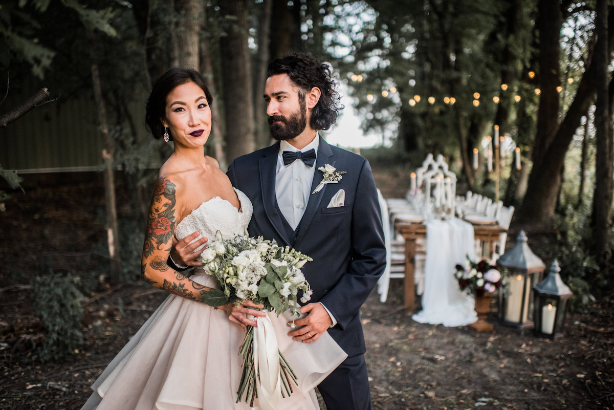 groom_lovingly_looking_at_bride_in_magical_forest_ceremony.jpg