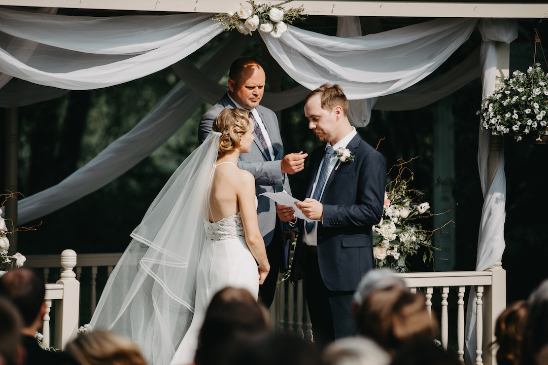 groom_reading_vows_to_bride_at_ceremony.jpg