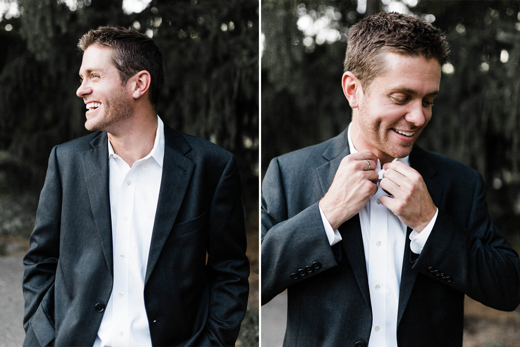 groom_suit_fixing_buttons_smiling.jpg