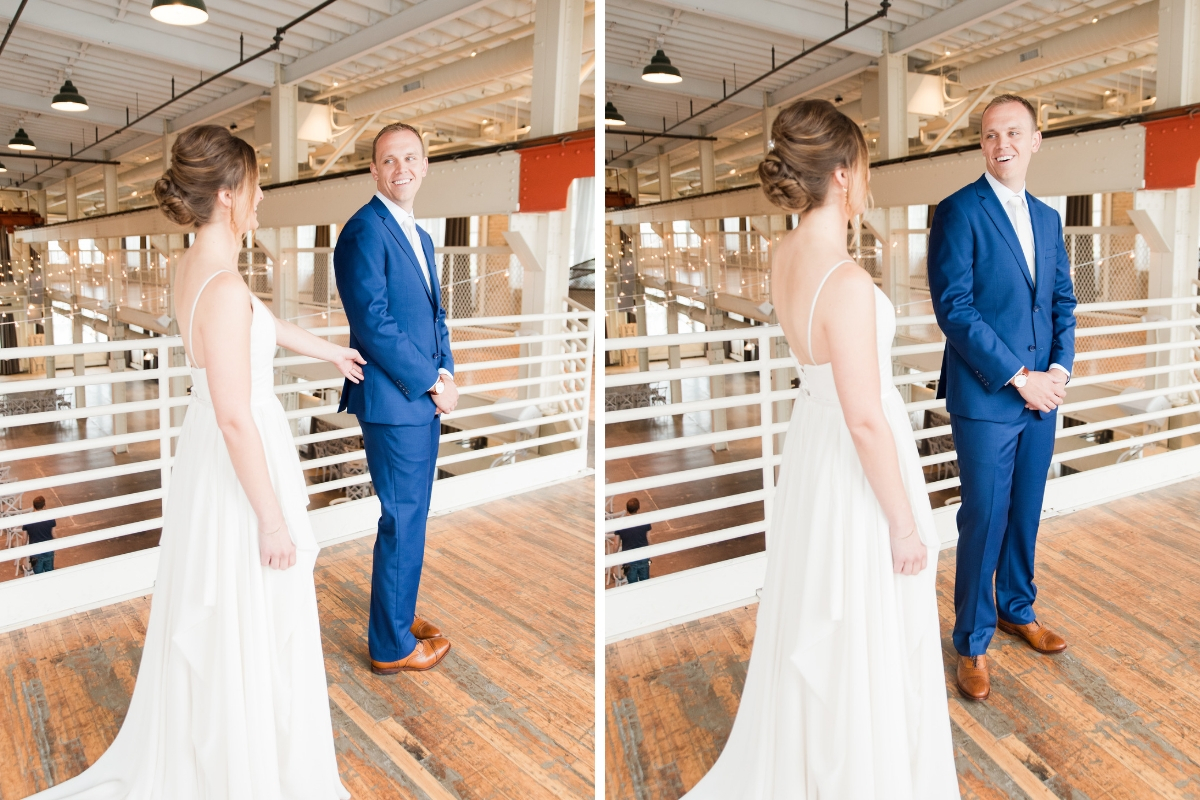 groom_turning_around_for_first_look_navy_blue_suit.jpg