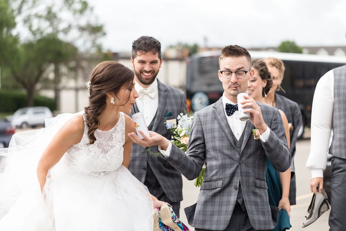 groomsman_feeding_bride_juice_can_wedding.jpg