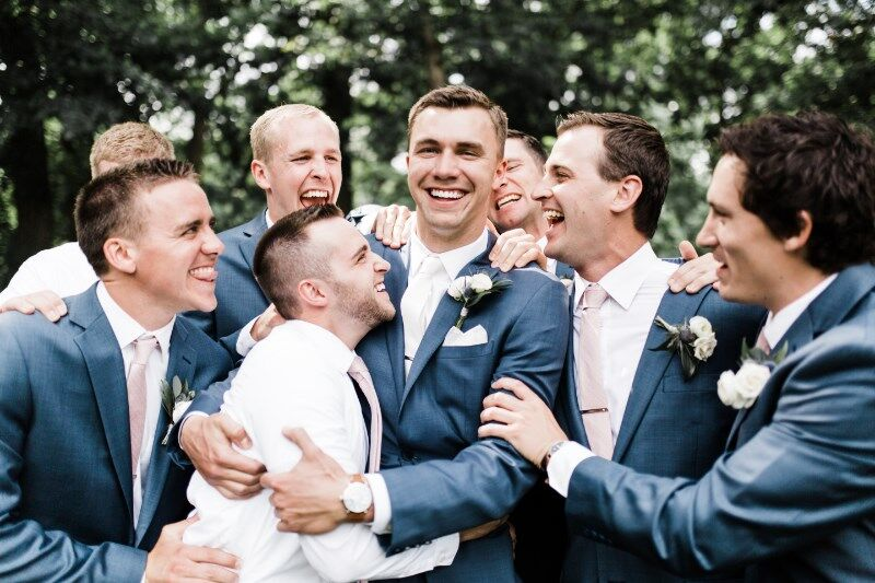 groomsmen_hugs_and_laughing_with_eachother.jpg