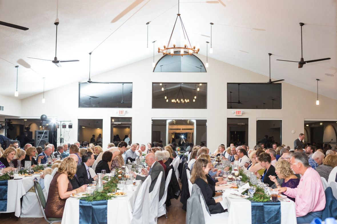 guests_eating_wedding_reception_tall_white_ceilings_mn.jpg