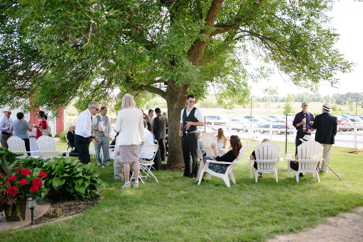 guests_lounging_in_white_chairs_farm_before_reception.jpg