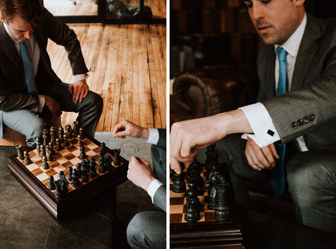 guys_playing_chess_in_suits.png