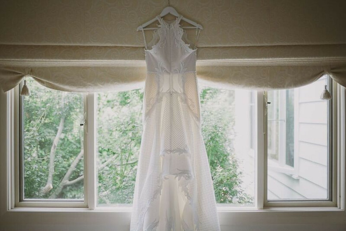 halter_wedding_dress_hanging_from_window.jpg