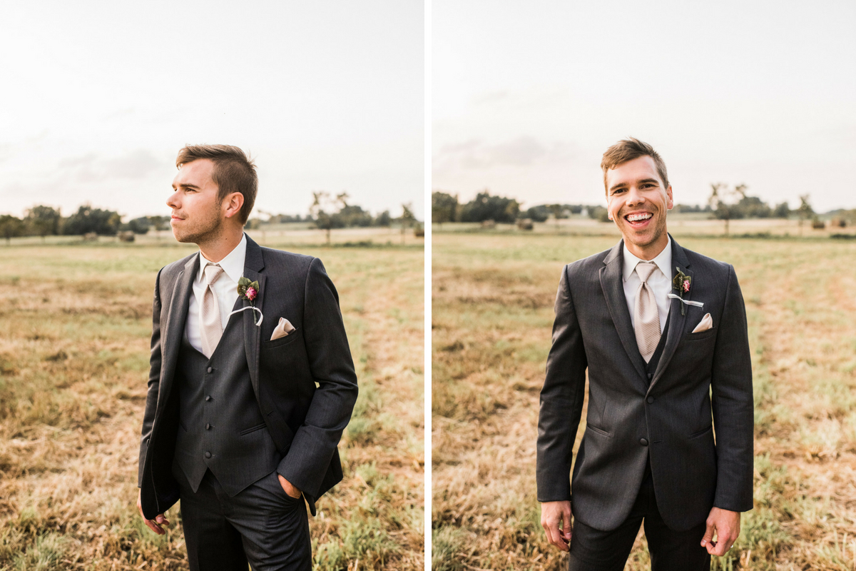handsom_groom_looking_away_in_field_smiling_at_camera.jpg