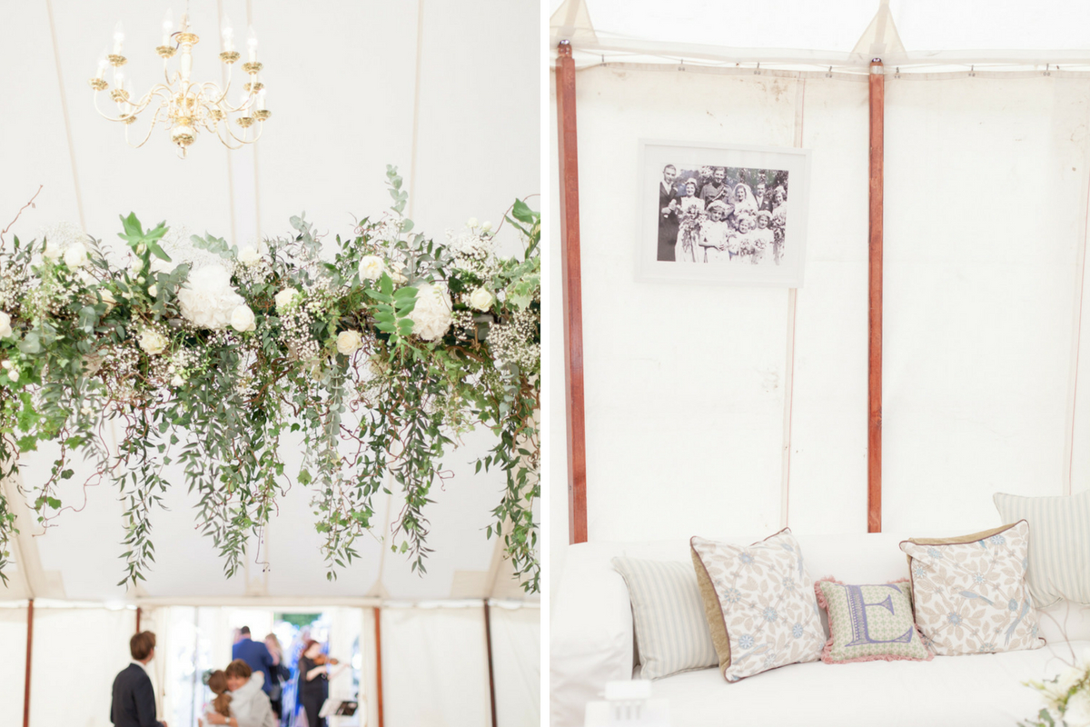 hanging_floral_chandelier_wedding_reception_tent_couch.jpg