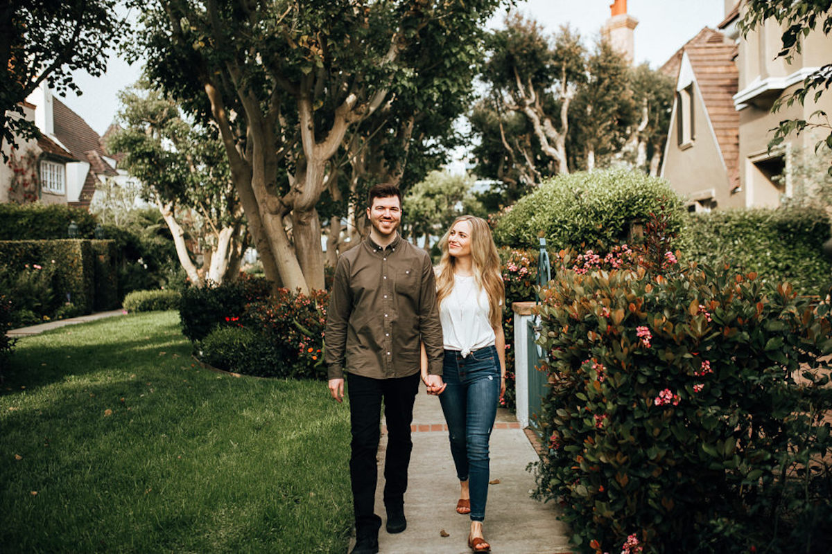 happy_couple_walking_on_marina_del_rey_sidewalk_flowers.JPG