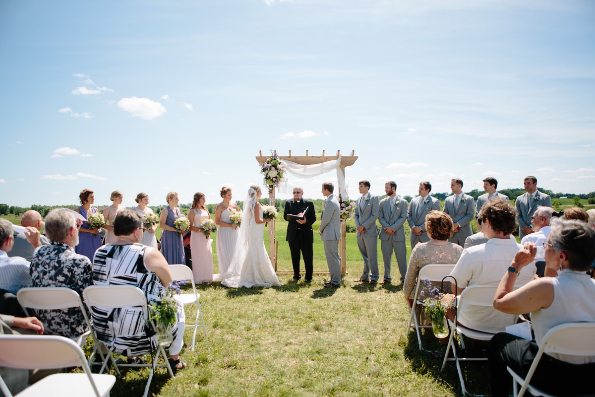 head_on_picture_of_wedding_ceremony_outside_farm.jpg