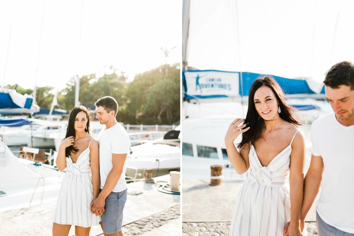 holding_hands_near_mexico_boat_marina_engagement.jpg