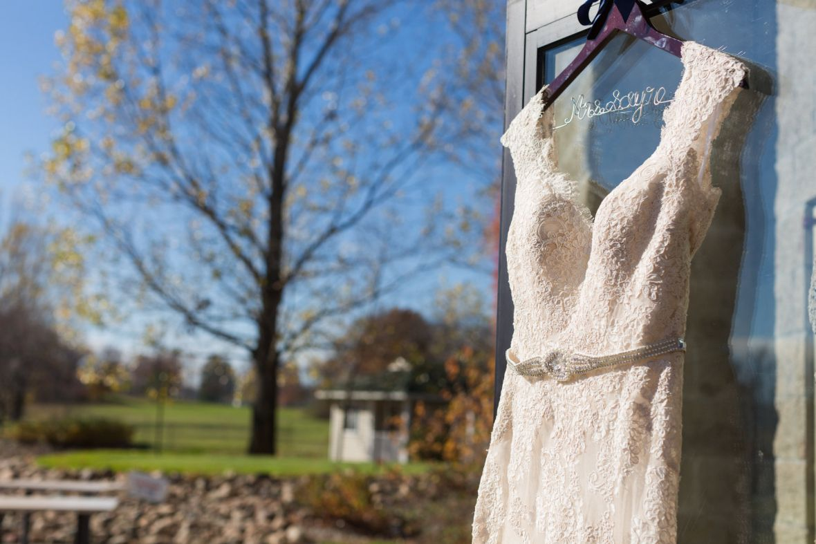 lace_dress_on_door_opened_to_outdoors.jpg