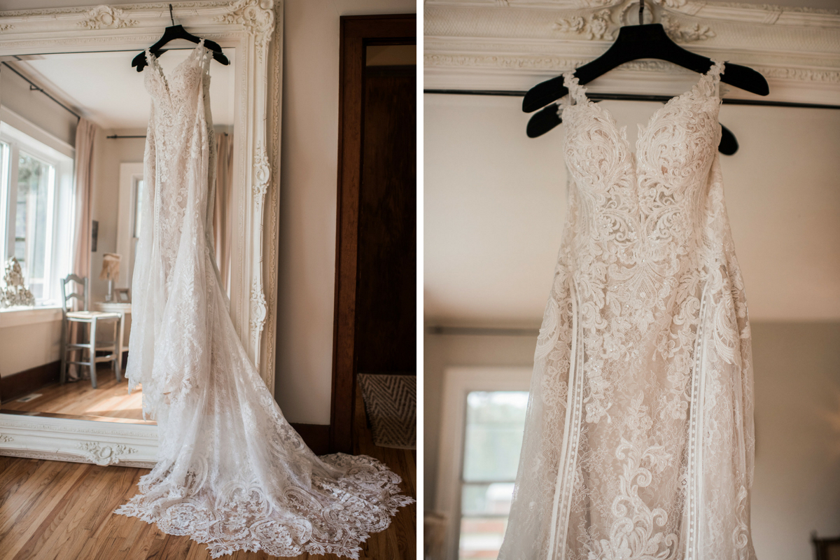lace_wedding_gown_hanging_from_grand_mirror_in_bright_white_room.jpg