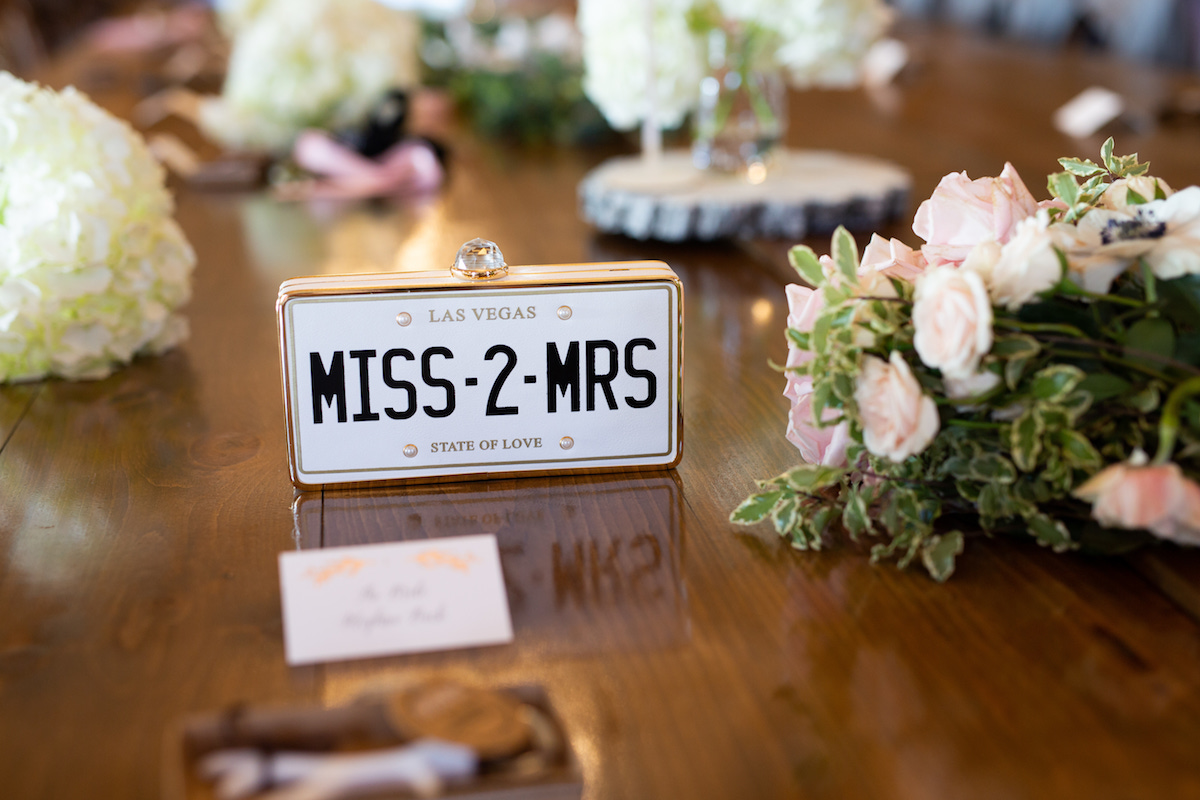 license_plate_wedding_decor_miss_2_mrs_on_wooden_table_with_bouquets.jpg