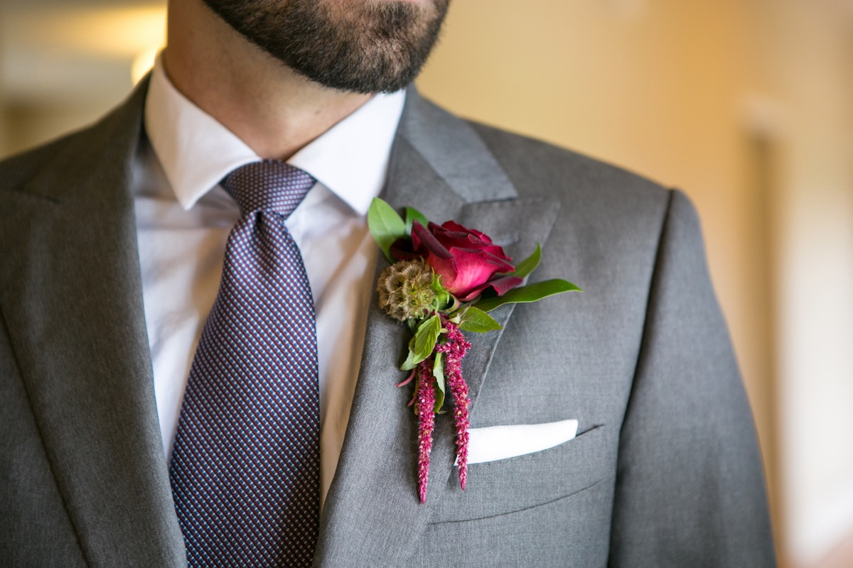 light_gray_groom_tux_red_blue_tie_with_bright_red_pink_boutineer.jpg
