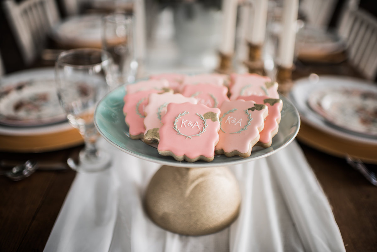 light_pink_wedding_monogrammed_cookies_on_gold_platter.jpg