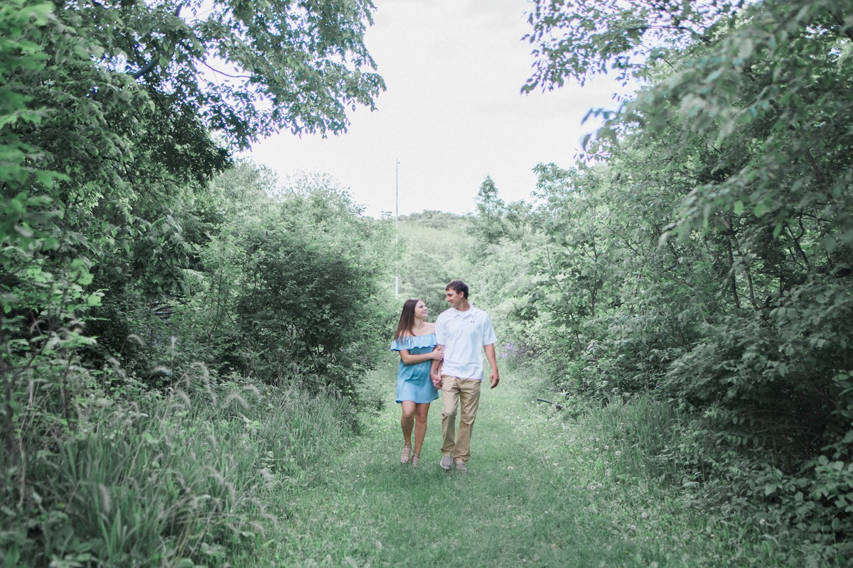 linking_arms_walking_in_field_engagement.jpg