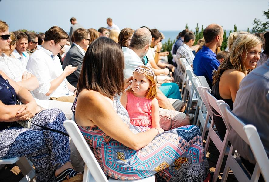 little_girl_pouting_wedding_ceremony_guests_chairs.jpg