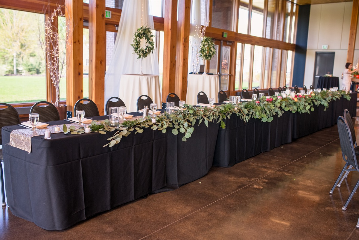long_black_table_cloth_wedding_party_table_greenery_on_edge.jpg