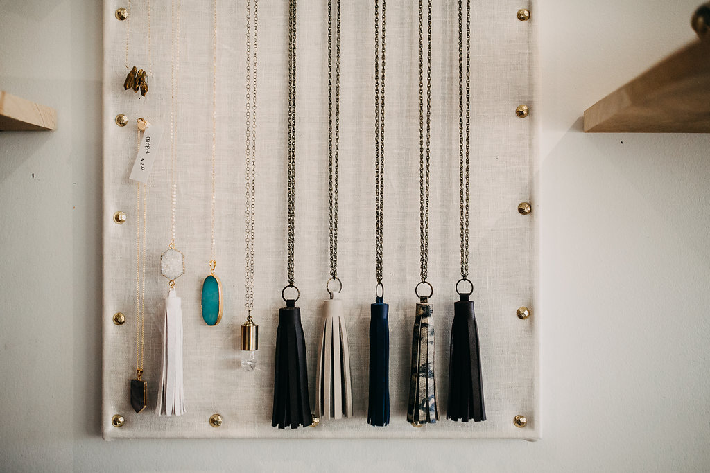 long_necklaces_hanging_on_wall_.jpg