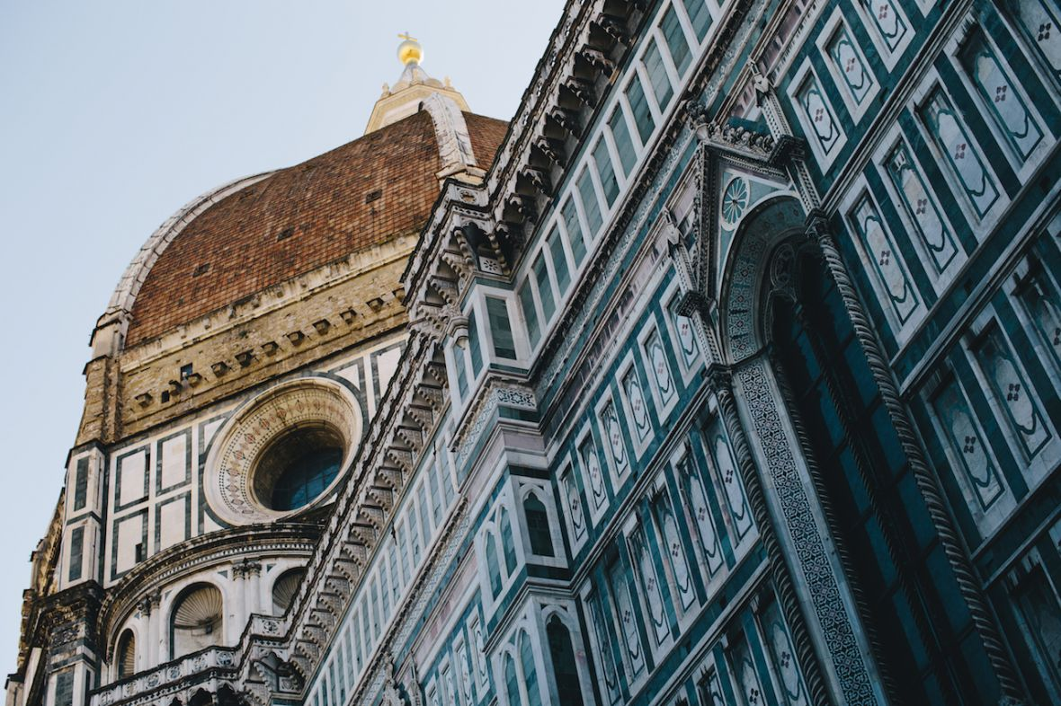 looking_up_at_historical_turquoise_buildings_venice_italy.jpg