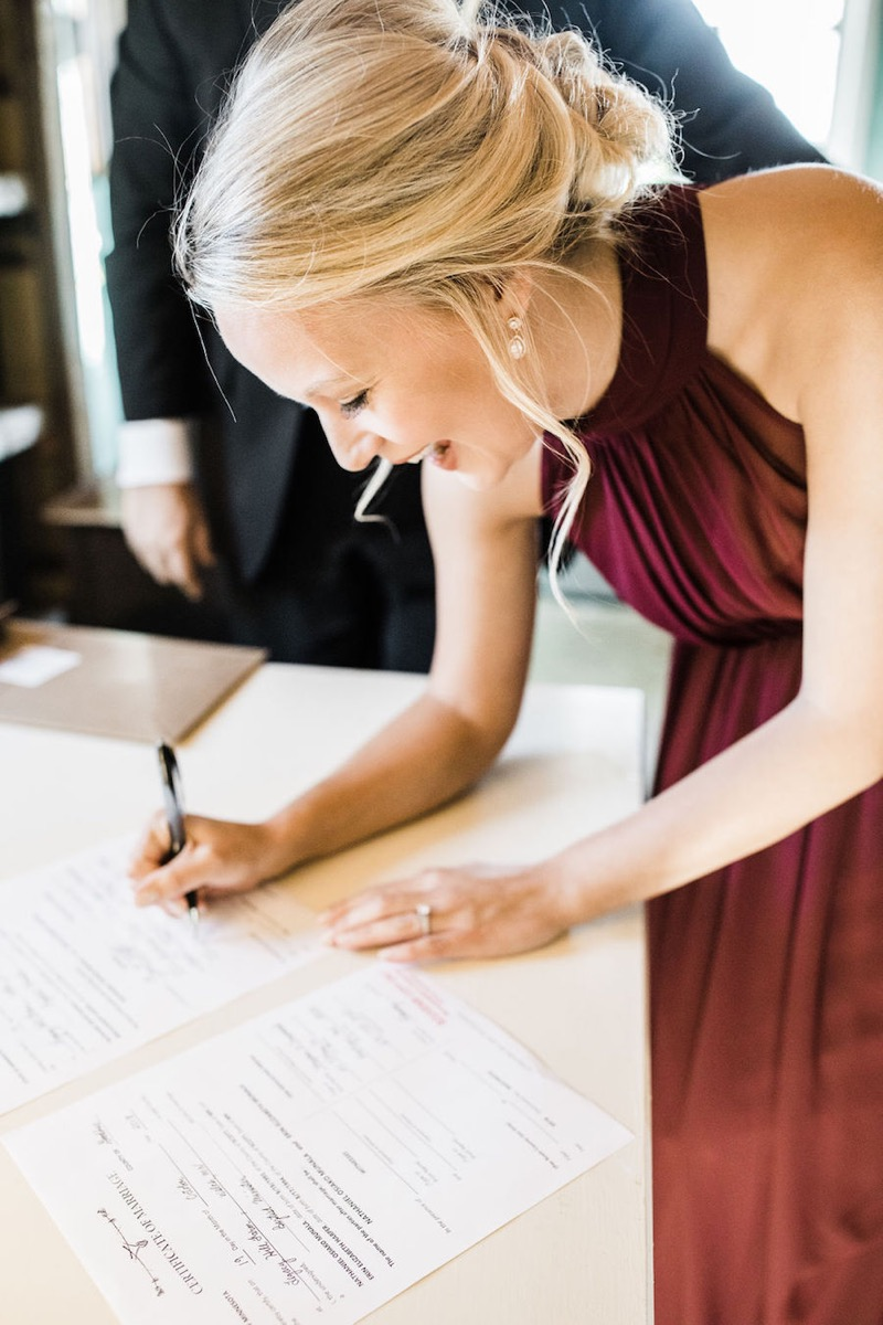 maid-of-honor-signs-marriage-license.jpg