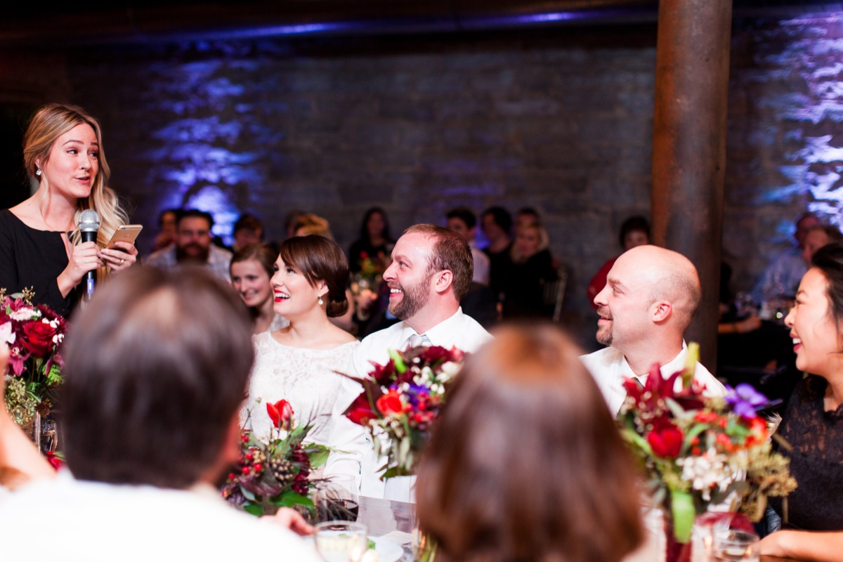 maid_of_honor_speech_earrings_red_lips_centerpieces_smiling.jpg