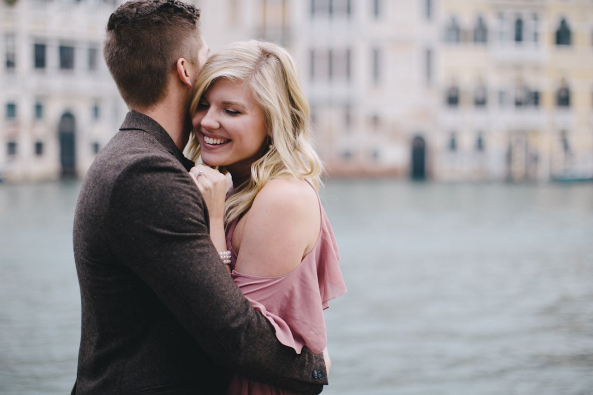 man_wrapping_arms_around_fiance_venice_italy_engagement.jpg