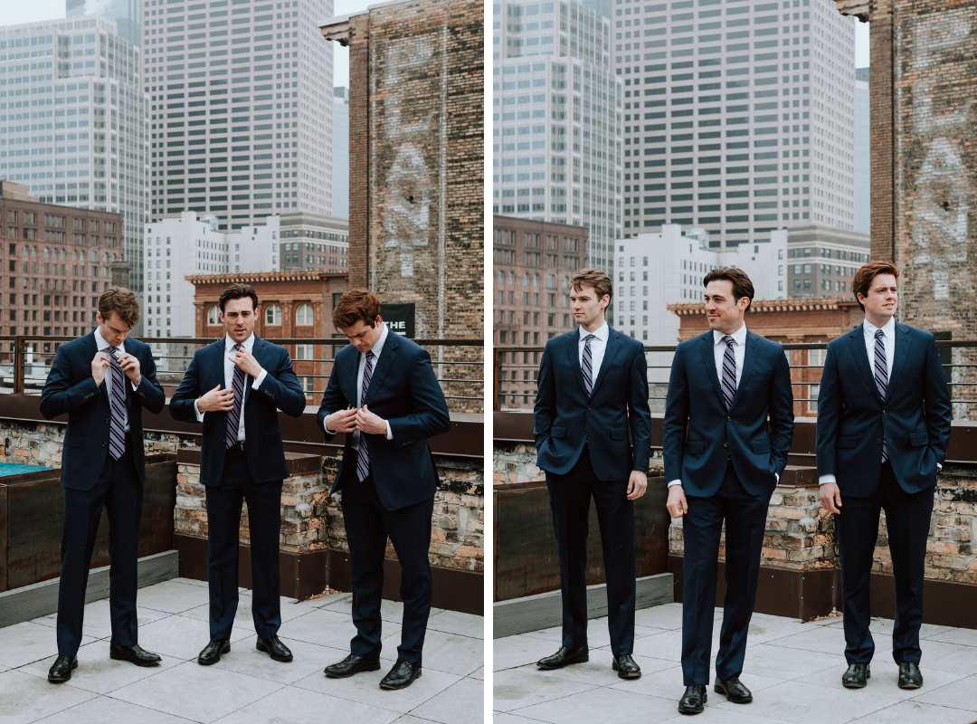 men_in_navy_suits_on_rooftop.png