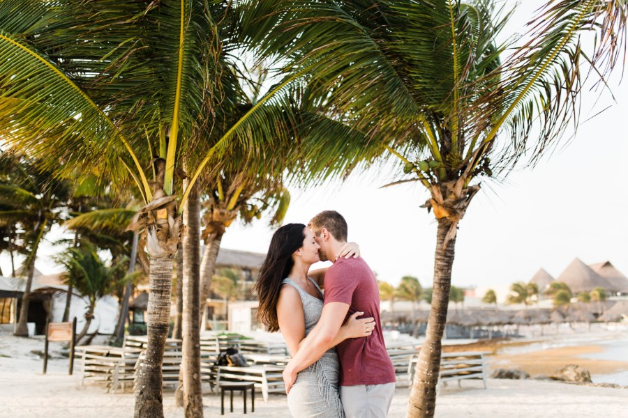 mexico_engagement_photos_couple_hugging_under_palm_trees.jpg