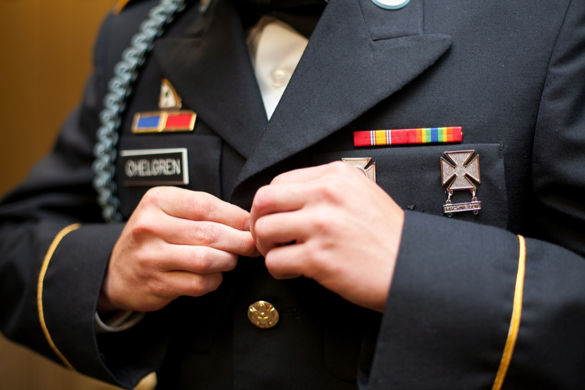 military_groom_buttoning_gold_buttons_wedding_day.jpg