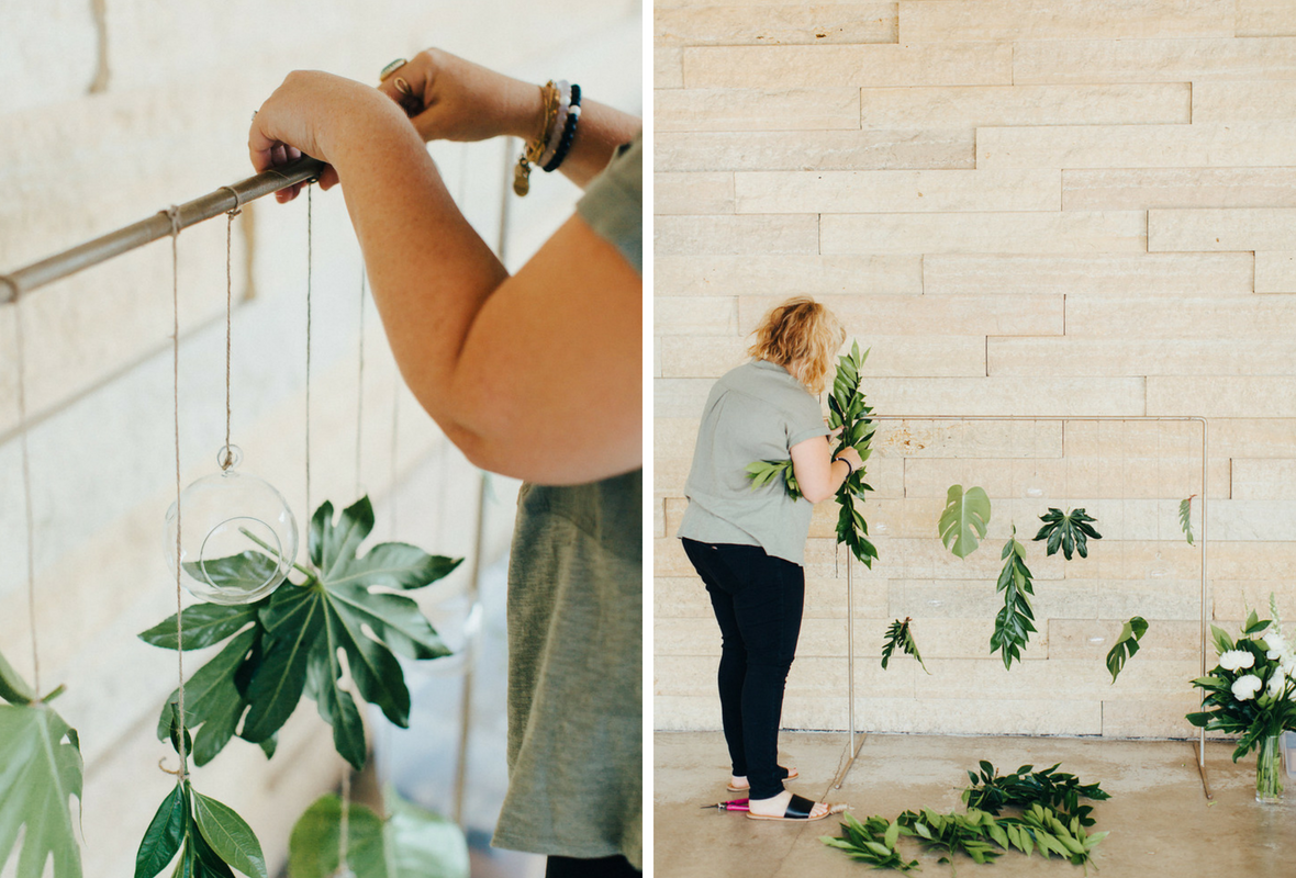 minnesota_wedding_designer_florist_setting_up_greenery_.png