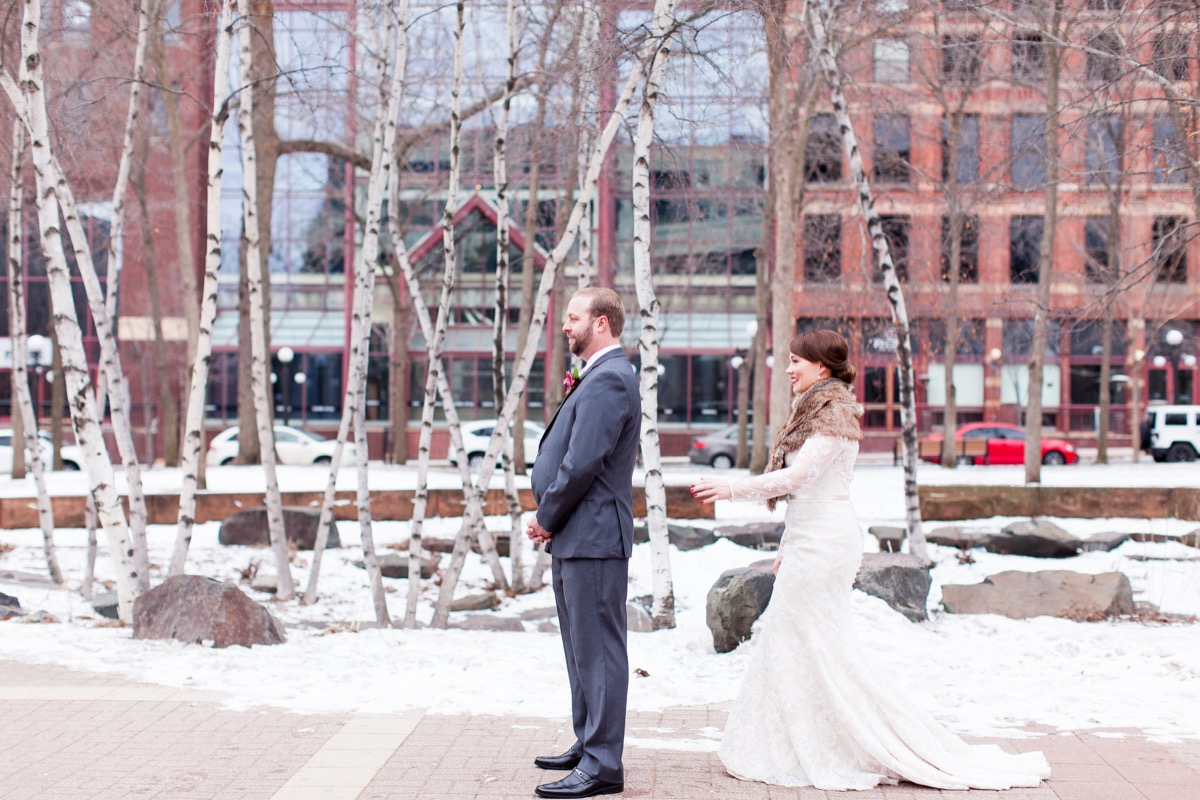 mn_first_look_bride_groom_downtown_white_lace.jpg