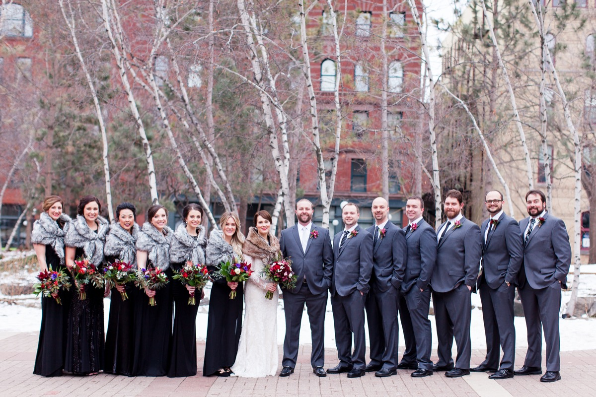 mn_wedding_party_bouquets_black_white_lace_dress_shawls_hands_in_pocket.jpg