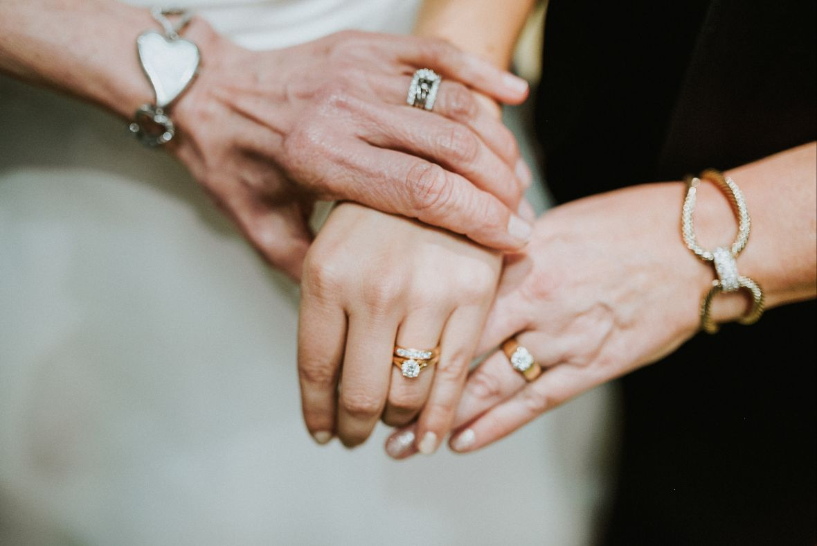 mom_daughter_grandma_hands_wedding_rings.jpg