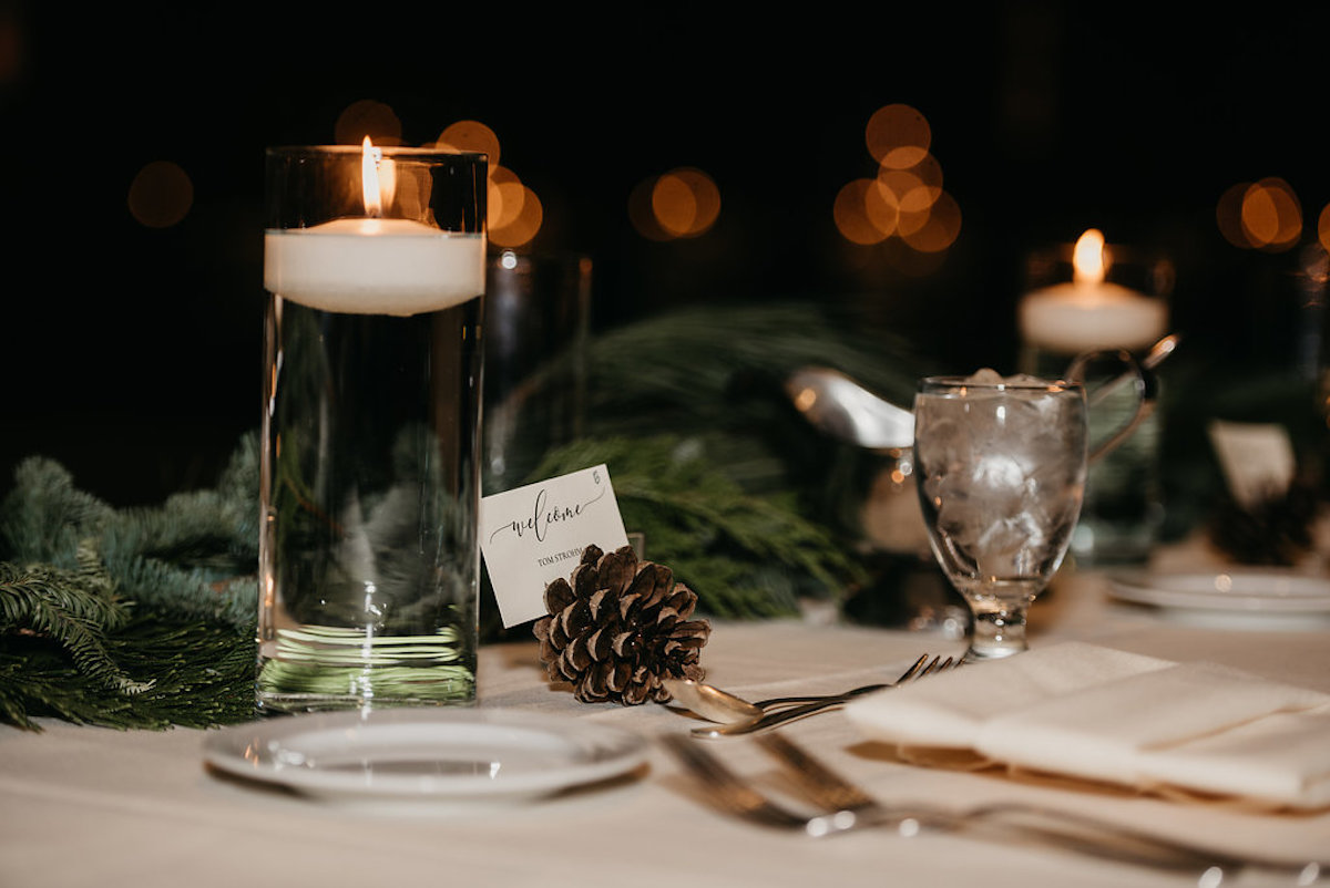 moody_city_wedding_clear_candle_vase_pinecone_table_cards.jpg