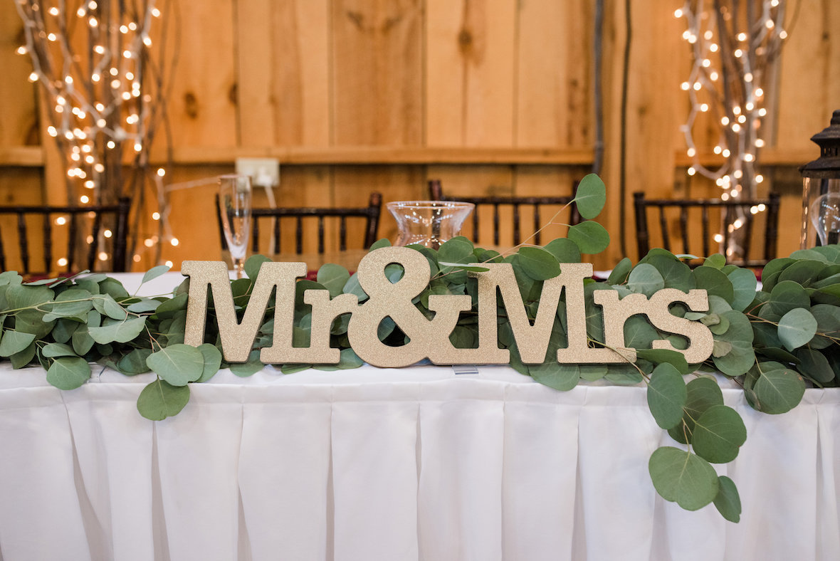mr-and-mrs-sign-against-greenery.jpg