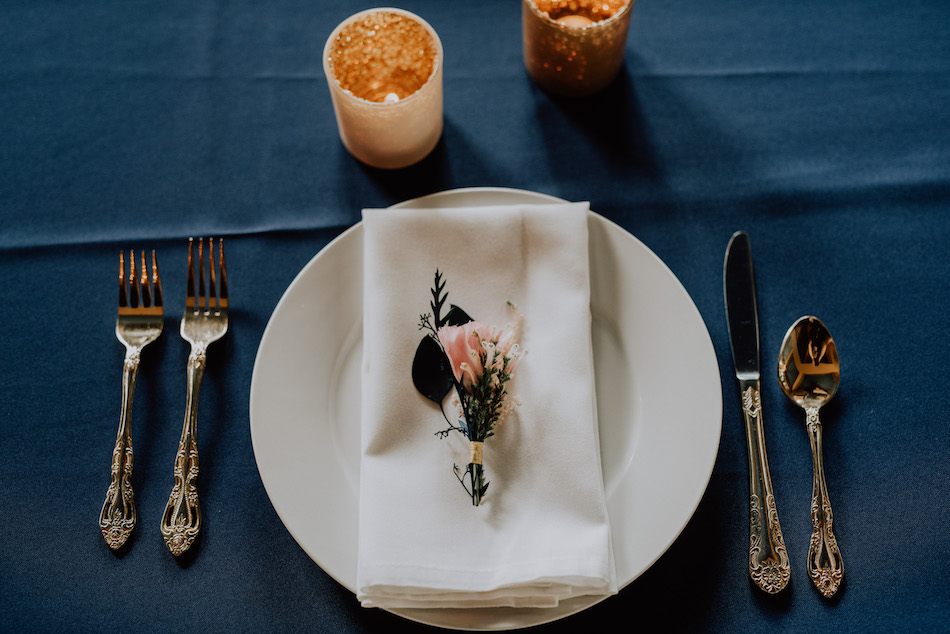 navy_table_with_coral_flowers.jpg