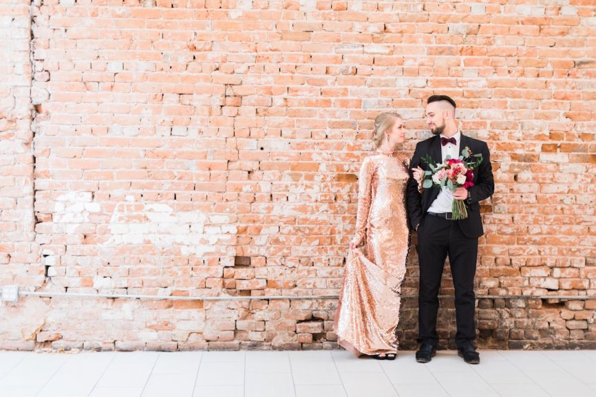new_years_eve_bride_and_groom_brick_wall.jpg