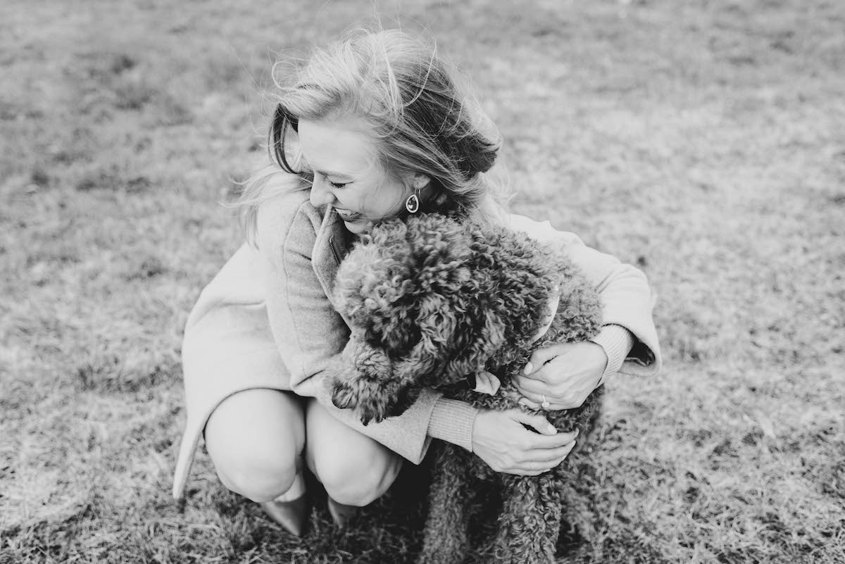newly_engaged_woman_hugging_poodle.jpg