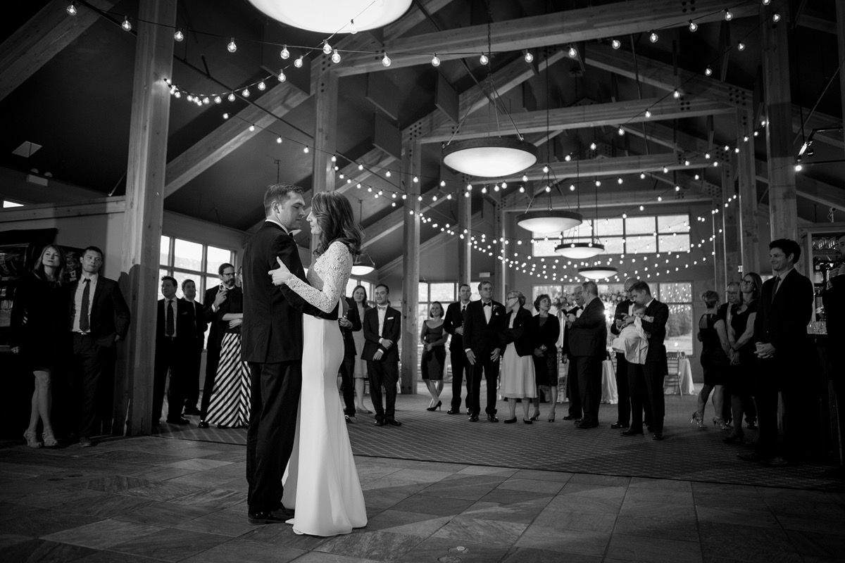 newlyweds_dancing_in_colorado_cabin_reception_black_and_white_photo.jpg