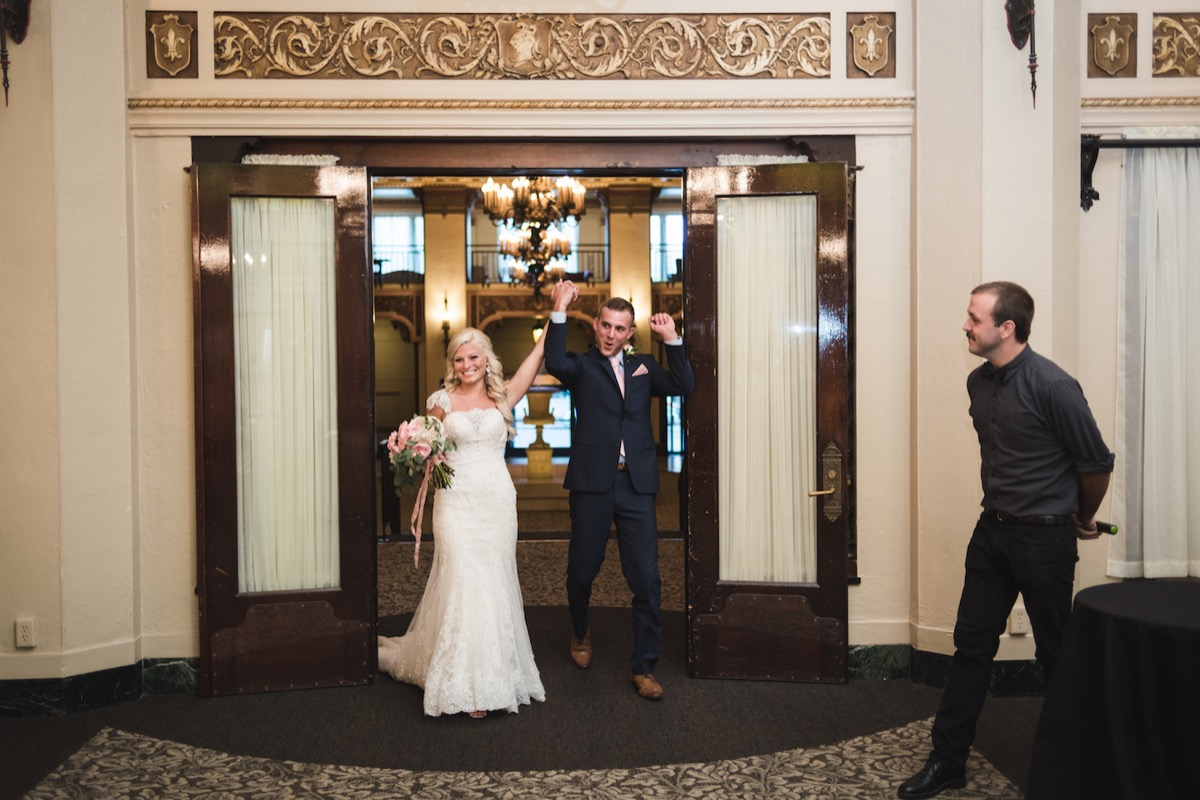 newlyweds_entering_wedding_reception_in_duluth_minnesota.jpg