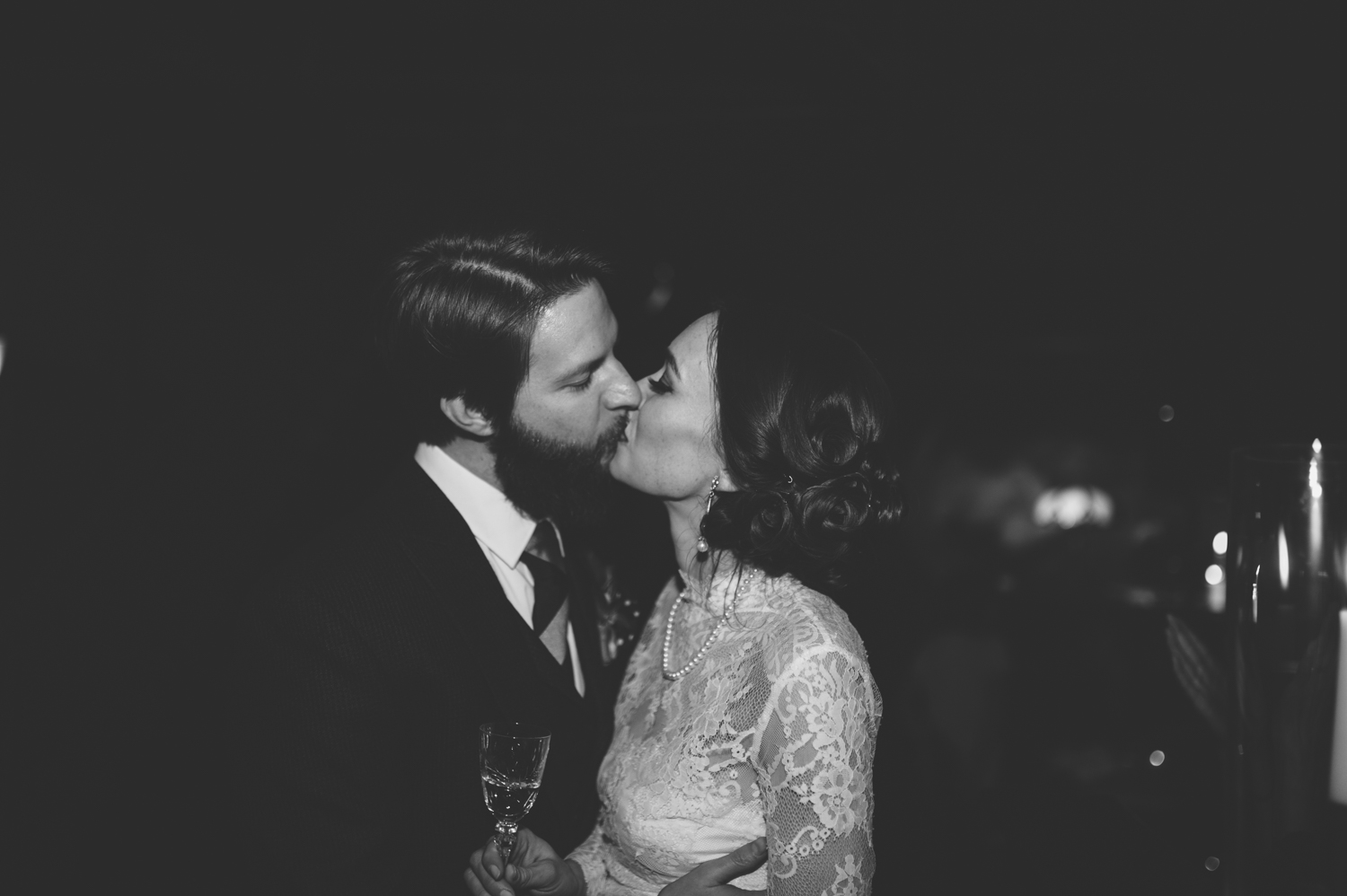 newlyweds_kissing_at_champagne_toast_wedding_reception.jpeg
